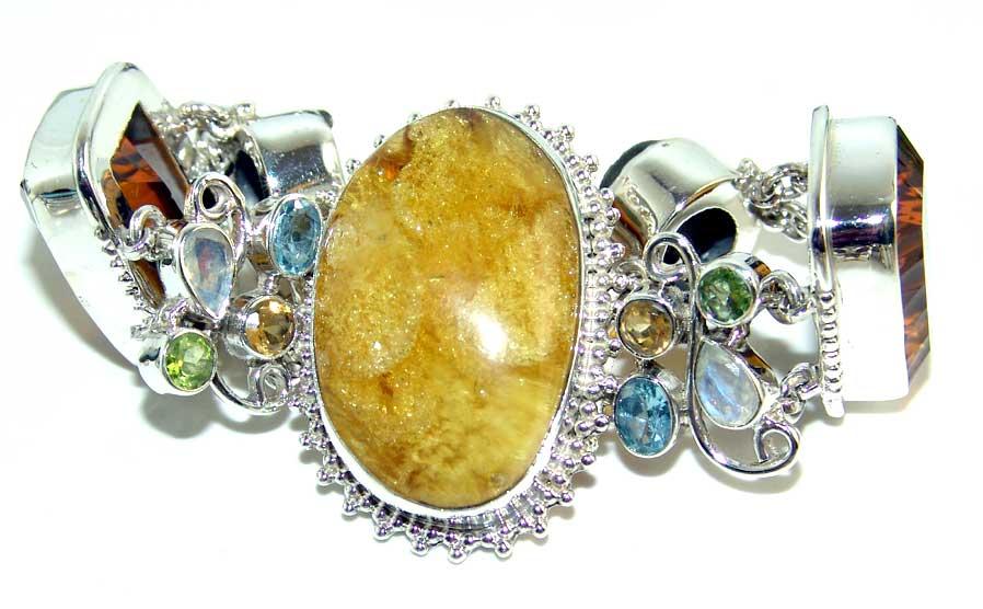 Kristali - drago i poludrago kamenje - Page 3 Amber%20fire%20topaz%20drusy%20topaz%20peridot